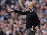 Pep Guardiola watches on during the Premier League game between Manchester City and Tottenham Hotspur on August 17, 2019