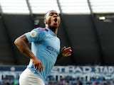 Raheem Sterling celebrates scoring during the Premier League game between Manchester City and Tottenham Hotspur on August 17, 2019