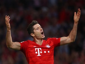 Robert Lewandowski scores twice as Bayern Munich held by Hertha Berlin