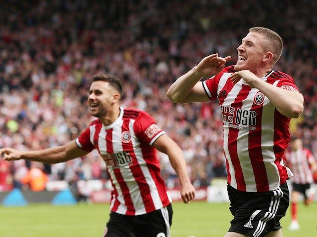 Sheffield United's John Lundstram celebrates scoring their first goal on August 18, 2019