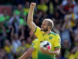 Norwich City's Teemu Pukki celebrates his hat-trick with the match ball after the match against Newcastle on August 17, 2019