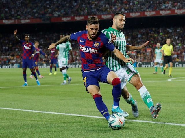 Barcelona's Carles Perez in action with Real Betis's Alfonso Pedraza in La Liga on August 25, 2019