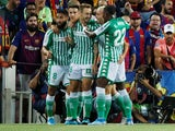 Real Betis players celebrate Nabil Fekir's goal against Barcelona in La Liga on August 25, 2019