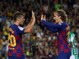 Antoine Griezmann and Sergi Roberto celebrate during Barcelona's La Liga clash against Real Betis on August 25, 2019