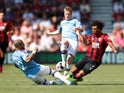 Bournemouth's Nathan Ake in action with Manchester City's Kyle Walker and Kevin De Bruyne on August 25, 2019