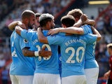 Manchester City's Sergio Aguero celebrates scoring their first goal with team mates on August 25, 2019