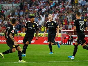 Borussia Dortmund's Jadon Sancho celebrates scoring their first goal on August 23, 2019
