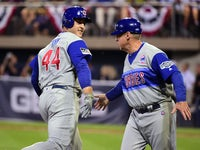 Chicago Cubs first baseman Anthony Rizzo (44) high fives third base coach Brian Butterfield (55) after hitting a home run in the fifth inning against the Pittsburgh Pirates at BB&T Ballpark at Historic Bowman Field.