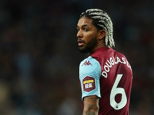 Aston Villa midfielder Douglas Luiz passes English exam