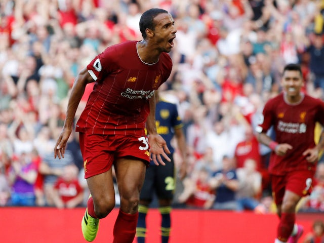 Joel Matip celebrates scoring during the Premier League game between Liverpool and Arsenal on August 24, 2019