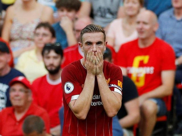 Liverpool skipper Jordan Henderson reacts on August 24, 2019