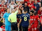 Liverpool are awarded a penalty and Arsenal's David Luiz is shown a yellow card by referee Anthony Taylor after a foul on Liverpool's Mohamed Salah on August 24, 2019