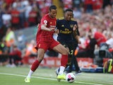 Joel Matip and Joe Willock in action during the Premier League game between Liverpool and Arsenal on August 24, 2019