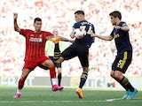 Roberto Firmino takes on Granit Xhaka and Sokratis during the Premier League game between Liverpool and Arsenal on August 24, 2019