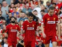 Mohamed Salah celebrates after getting his side's third during the Premier League game between Liverpool and Arsenal on August 24, 2019