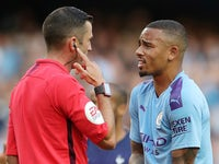 Manchester City's Gabriel Jesus remonstrates with referee Michael Oliver after the match on August 17, 2019