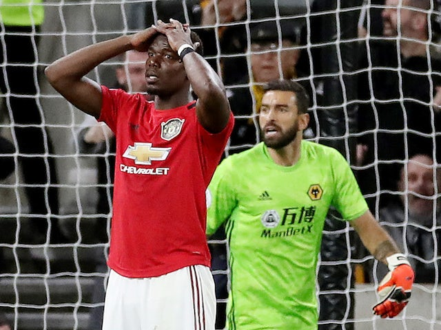 Manchester United's Paul Pogba reacts after his penalty is saved by Wolverhampton Wanderers' Rui Patricio on August 19, 2019