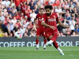 Mohamed Salah scores from the spot during the Premier League game between Liverpool and Arsenal on August 24, 2019