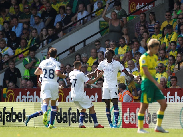Tammy Abraham celebrates with teammates after scoring during the Premier League game between Norwich City and Chelsea on August 24, 2019
