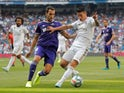 Real Madrid's James Rodriguez in action with Real Valladolid's Kiko Olivas in La Liga on August 24, 2019