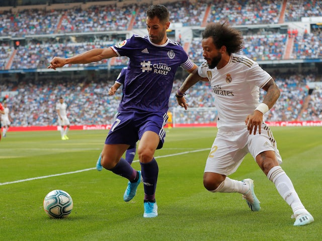 Real Madrid's Marcelo in action with Real Valladolid's Javi Moyano in La Liga on August 24, 2019