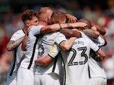Swansea City's Borja Baston celebrates scoring their third goal with team mates on August 25, 2019