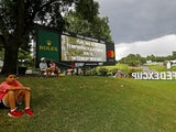 A view of a leader board announcing that play has been suspended during the third round of the Tour Championship golf tournament at East Lake Golf Club on August 24, 2019