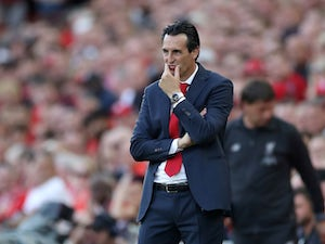 Unai Emery watches on during the Premier League game between Liverpool and Arsenal on August 24, 2019