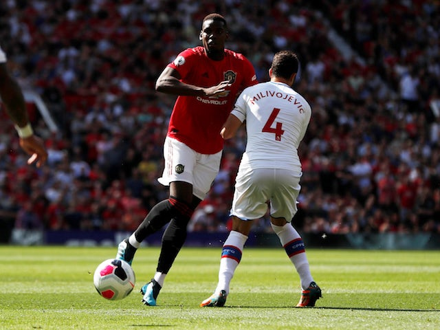 Manchester United's Paul Pogba in action with Crystal Palace's Luka Milivojevic in the Premier League on August 24, 2019