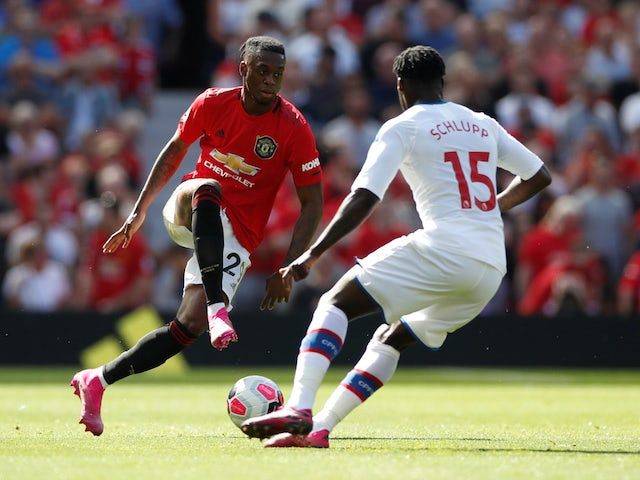 Manchester United's Aaron Wan-Bissaka in action with Crystal Palace's Jeffrey Schlupp in the Premier League on August 24, 2019