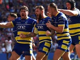 Warrington Wolves players celebrate during the Challenge Cup final on August 24, 2019