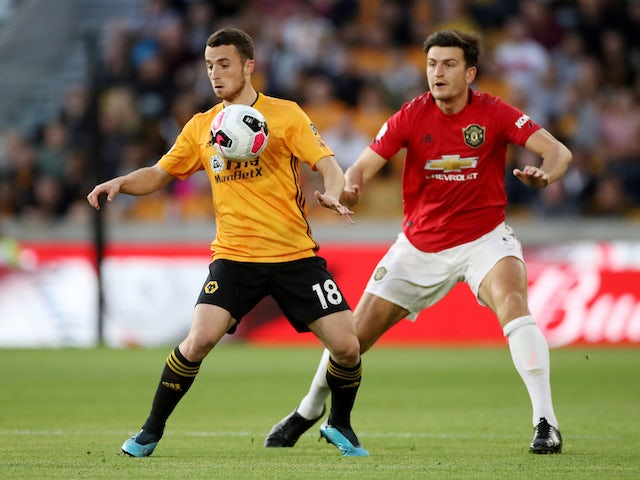 Diogo Jota and big Harry Maguire in action during the Premier League game between Wolverhampton Wanderers and Manchester United on August 19, 2019