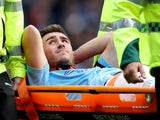 Manchester City's Aymeric Laporte is stretchered off on August 31, 2019