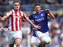 Stoke's Liam Lindsay and Birmingham's Lukas Jutkiewicz in action on August 31, 2019