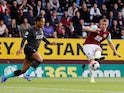 Virgil van Dijk and Chris Wood in action during the Premier League game between Burnley and Liverpool on August 31, 2019
