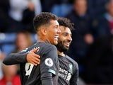 Roberto Firmino celebrates with Mohamed Salah after scoring during the Premier League game between Burnley and Liverpool on August 31, 2019