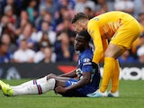 Kepa helps Chelsea teammate Kurt Zouma to his feet on August 31, 2019