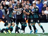 Wayne Routledge celebrates scoring late for Swansea City on August 31, 2019