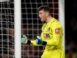 Bournemouth's Mark Travers celebrates saving a penalty during the shootout on August 28, 2019