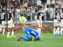 Napoli's Kalidou Koulibaly looks dejected after scoring an own goal and Juventus' fourth on August 31, 2019
