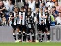 Fabian Schar celebrates scoring with Newcastle teammates on August 31, 2019