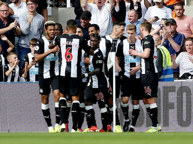 Fabian Schar celebrates scoring with Newcastle teammates on August 31, 2019