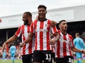 Ollie Watkins celebrates scoring for Brentford on August 31, 2019