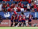 Osasuna players celebrate Roberto Torres's goal against Barcelona in La Liga on August 31, 2019