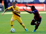 Barcelona's Carles Perez in action with Osasuna's Pervis Estupinan in La Liga on August 31, 2019