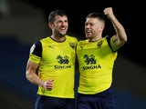 Oxford United's John Mousinho celebrates winning the penalty shootout with Jamie Mackie on August 27, 2019