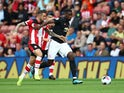 Manchester United midfielder Paul Pogba in action with Southampton's Danny Ings in the Premier League on August 31, 2019