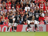 Manchester United players celebrate Daniel James's goal against Southampton in the Premier League on August 31, 2019