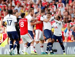 Tottenham Hotspur's Harry Winks and Arsenal's Sokratis Papastathopoulos clash on September 1, 2019