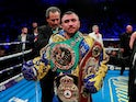 Vasyl Lomachenko poses as he celebrates winning the fight against Luke Campbell